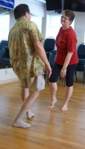 Photo: two people dancing facing each other smiling