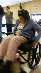 Photo of a dancer spinning to the right using a wheelchair