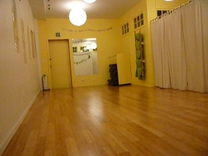 Photo of studio floor and yellow walls.
