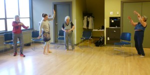Photo: four women dancing in a semi circle each doing a different move