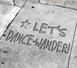 "Image of pavement with ""Let's Dance-Wander"" written on it"