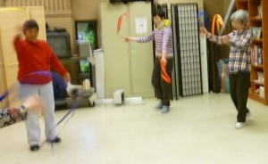 Blurry photo: three dancers with ribbons whirling through the air.