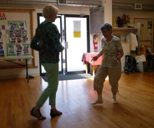 Photo: two adults dancing facing each other looking down