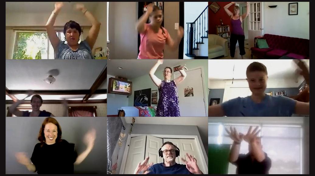 Nine dancers lift their elbows upwards.